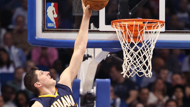 The Indiana Pacers' Damjan Rudez (9) dunks late in the game against Orlando Magic at the Amway Center in Orlando, Fla., on Sunday, Jan. 25, 2015. The Pacers won, 106-99. (Stephen M. Dowell/Orlando Sentinel)