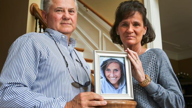 Charlie and Melinda Tewell with a photo of their daughter, Ryann, 24, who was killed while crossing the street at 2nd and Main Streets.March 14, 2016