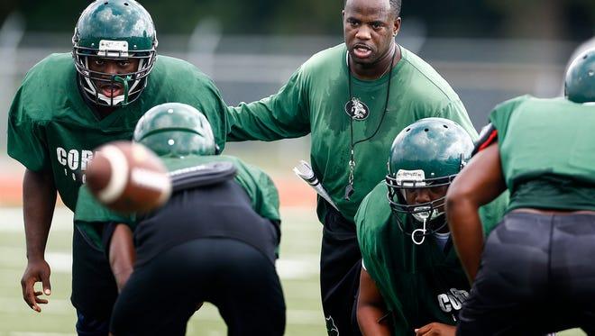 Cordova High School head football coach Anthony Jones, Jr., ( middle) runs his team through drills during a recent practice.