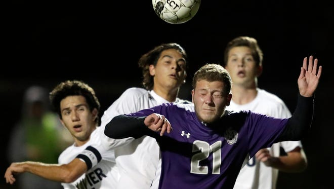 Marinette High School's #21 Federico Finamore gainst Xavier High School during their WIAA Division 3 regional soccer game on Thursday, October 19, 2017, in Appleton, Wis. Wm. Glasheen/USA TODAY NETWORK-Wisconsin