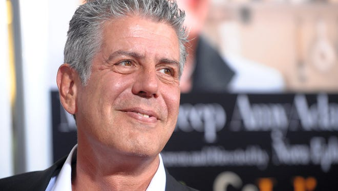 "In this July 30, 2009 file photo, Anthony Bourdain attends the premiere of ""Julie & Julia"" at The Ziegfeld Theatre, in New York."