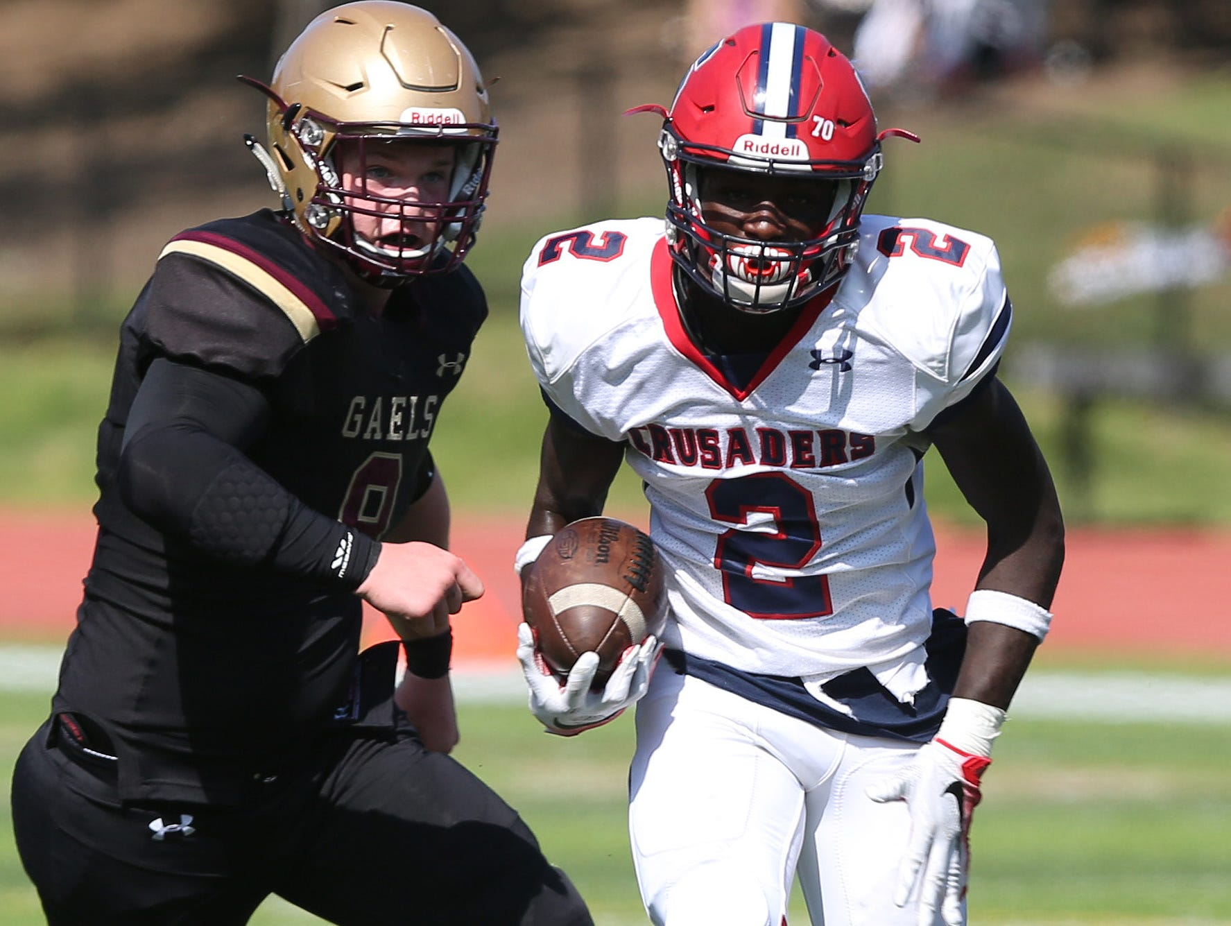 Stepinac's Atrilleon Williams (2) breaks away from Iona's Robert Rohan (8) as he runs into the end zone in the second quarter for his second touchdown of the game, during football action at Iona Prep in New Rochelle Sept. 17, 2016. Stepinac won the game 42-34.
