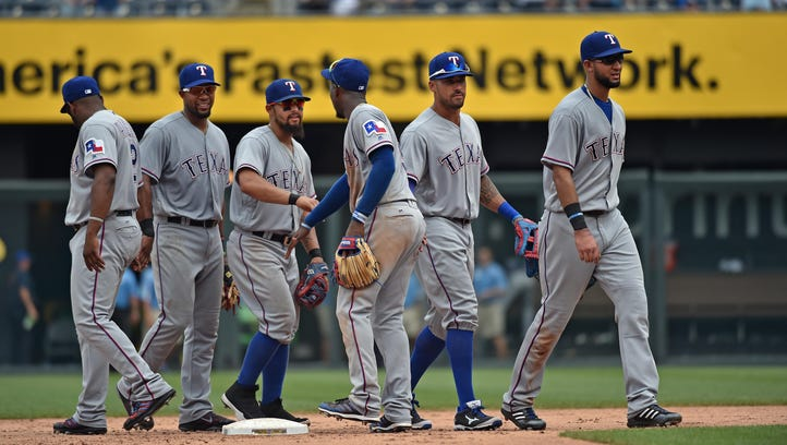 Texas Rangers players celebrate after beating the Kansas