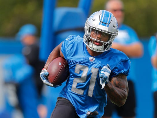 Lions running back Ameer Abdullah carries the football