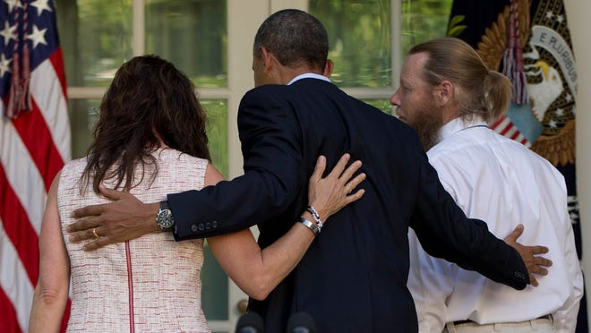 President Obama walks with Jani Bergdahl, left, and Bob Bergdah to the Oval Office on May 31 after speaking about the release of their son, U.S. Army Sgt. Bowe Bergdahl.