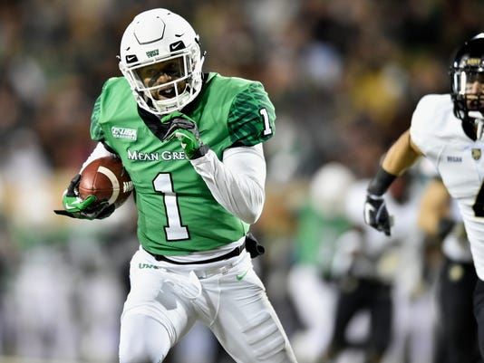 North Texas wide receiver Turner Smiley (1) catches a pass and scores a touchdown during an NCAA college football game against Army Saturday, Nov. 18, 2017, in Denton, Texas. (Jeff Woo/The Denton Record-Chronicle via AP)