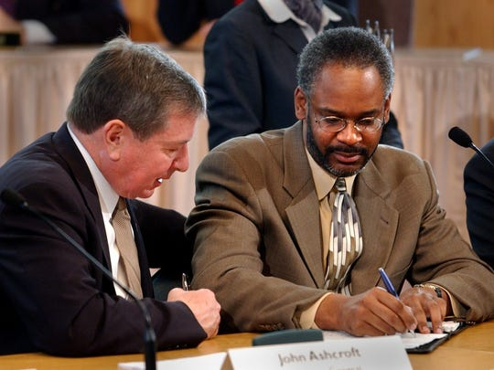 The Rev. Damon Lynch III, right, in 2002 signs Cincinnati's Collaborative Agreement as then-U.S. Attorney General John Ashcroft looks on.  Enquirer file Text: 2002.0412.02.1 --DIGITAL IMAGE -- ASHCROFT -- U.S. Attorney General John Ashcroft, left, talks with Reverend Damon Lynch III, a representative of the Black United Front, as he signs a settlement agreement between the Department of Justice, The City of Cincinnati and the Cincinnati Police Department Friday April 12, 2002 at Cincinnati City Hall. The agreement outlines new procedures and policies dealing with use of force, training, supervision and discipline of officers for the Cincinnati Police Department. Cincinnati Enquirer photo by Gary Landers. gl
