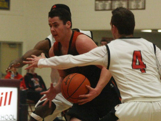 Northville's Justin Zimbo drives to the rack Monday