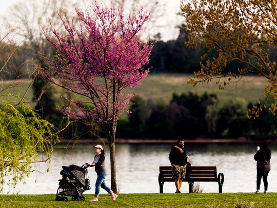 People enjoy a warm sunny evening at Concord Park in