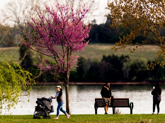 People enjoy a warm sunny evening at Concord Park in Farragut, Tennessee on Tuesday, April 10, 2018.