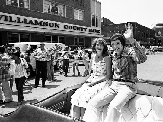 Darrell Waltrip, right, and his wife Stevie waves to