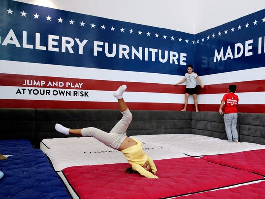 Displaced kids play while sheltering at Gallery Furniture, Wednesday, Aug. 30, 2017, in Richmond, Texas.