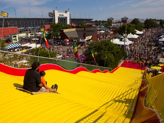 Fair goers enjoy the giant slide at the Wisconsin State