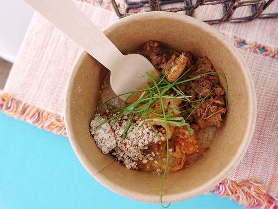 Smoked broth congee with mesquite smoked black garlic