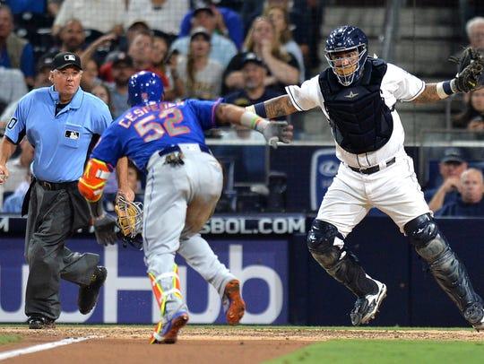 San Diego Padres catcher Hector Sanchez (44) and New