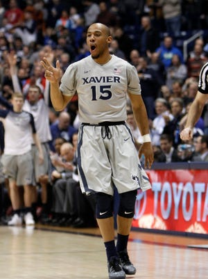 Xavier Musketeers guard Myles Davis (15) reacts after making a three-point shot against the Butler Bulldogs during the first half at the Cintas Center.