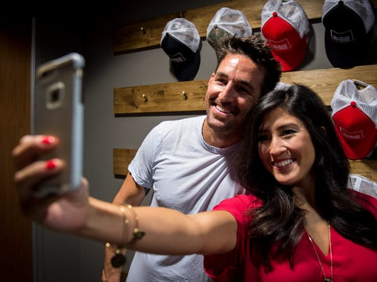 Amy Spain, of Nashville, takes a selfie with Jake Owen during an event at WKDF on July 18, 2016, in Nashville.
