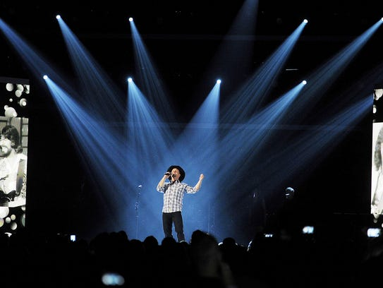 Garth Brooks performs during the 48th Annual ACM Awards