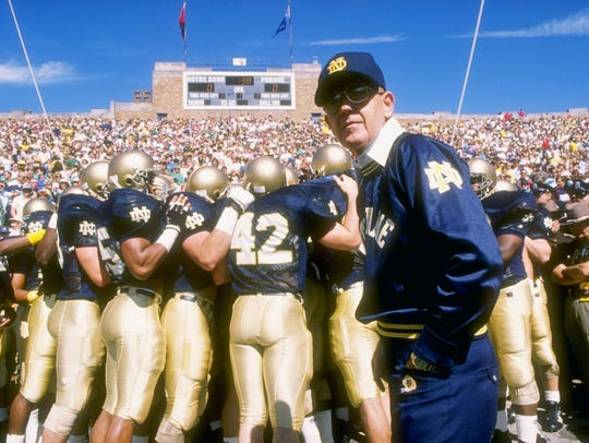 Lou Holtz stands on the sidelines during the first
