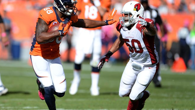 Arizona Cardinals middle linebacker Larry Foote chases Broncos wide receiver Demaryius Thomas on Oct 5, 2014 at Mile High in Denver.
