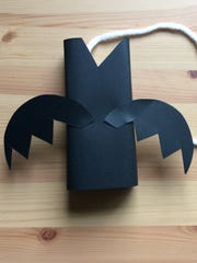 Cover a soap box with black paper, leaving a couple