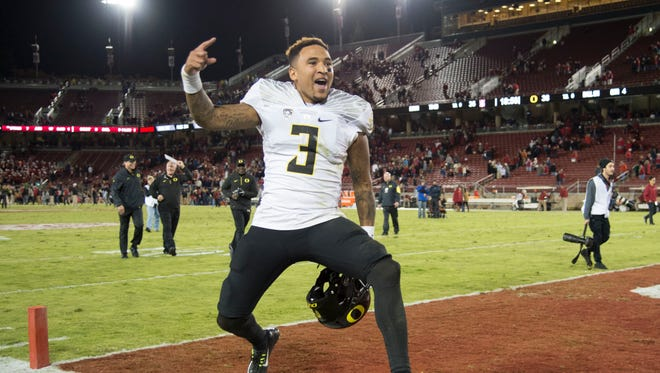 Oregon Ducks quarterback Vernon Adams Jr. celebrates.