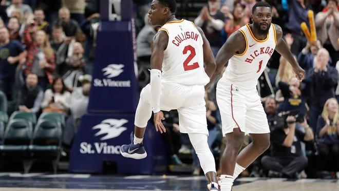 Indiana Pacers guards Darren Collinson (2) and Lance Stephenson celebrate near the end of 107-100 victory over the Detroit Pistons, who are in the midst of a 1-3 skid. (AP Photo/Darron Cummings)