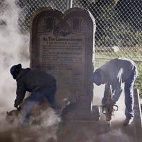 Workers place the Ten Commandments monument in its new home at the Oklahoma Council of Public Affairs, just down the street from the state Capitol in Oklahoma City early Oct. 6, 2015.