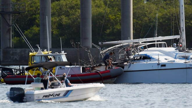 A 35-foot catamaran caught fire in the Indian River Lagoon Tuesday, after the vessel hit a power line south of the Alma Lee Loy Bridge that crosses the Indian River Lagoon in Vero Beach. There was no one on board the vessel when the fire broke out. Power was briefly shut off on the barrier island near the bridge as a result of the incident.