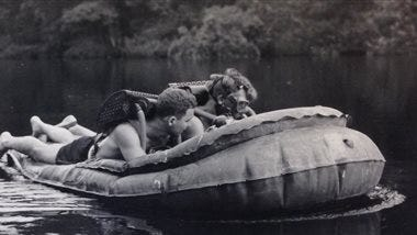 In this undated 1944 photo, two combat swimmers with the Maritime Unit of the Office of Strategic Services conduct a training exercise in Helford, England for a mission to destroy German U-boat submarine pens located in France during World War II. The Maritime Unit's combat swimmers and other operatives carried out seaborne clandestine missions in the Atlantic, Pacific and Mediterranean theaters of World War II and pioneered many of the intelligence-gathering techniques and commando-style tactics used by today's U.S. special forces.