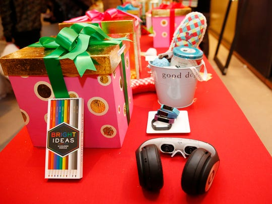 """Holiday gift items chosen by Oprah Winfrey for the 2016 Christmas giving season are displayed at """"O,The Oprah Magazine,"""" Tuesday, Nov. 1, 2016, in New York, during a sneak preview of """"Oprah's Favorite Things 2016."""" The Glyph,"""" a """"Star Wars"""" worthy techno-gift, when placed over the eyes and plugged into an HDMI device, lower right, allows the wearer do everything from checking email to watching movies in digital HD. Colored pencils for drawing in a coloring book while relieving the day's stress, are shown, lower left."""