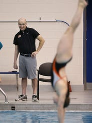 RIT diving coach Cliff Devries likes what he sees on