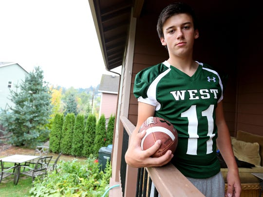 "West Salem freshman quarterback Garrett Moore at his home, Thursday, Oct. 7, 2015, in West Salem, Ore. Moore was suspended from school on accusations he ""inappropriately touched"" a teammate while taking a snap under center during practice."