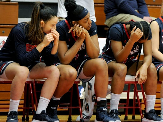 Robert Morris players shows their dejection late in the fourth quarter of an NCAA college basketball game in the NEC Championship against St. Francis Sunday, March 11, 2018, at St. Francis University in Loretto. St. Francis defeated Robert Morris 66-56. (Pam Panchak/Pittsburgh Post-Gazette via AP)