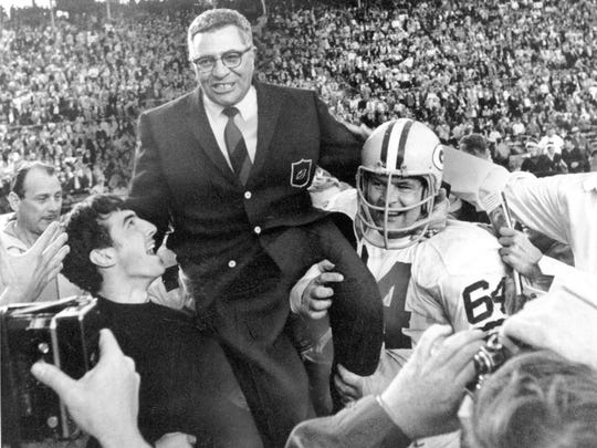 In this Jan. 14, 1968, photo, Green Bay Packers coach Vince Lombardi is carried off the field after his team defeated the Oakland Raiders 33-14 in Super Bowl II in Miami, Fla.