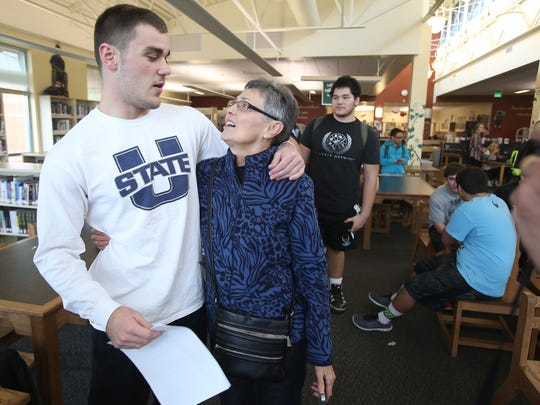 West Salem High School senior Cade Smith, who signed with Utah State, gets a hug from his grandmother Ruth Johnson on Wednesday, Feb. 4 , 2015, in Salem, Ore.