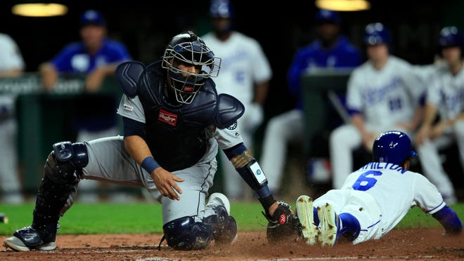 Seattle Mariners catcher Omar Narvaez, left, is late tagging Kansas City Royals' Billy Hamilton (6) during the third inning of a baseball game at Kauffman Stadium in Kansas City, Mo., Tuesday, April 9, 2019. Hamilton scored from second on a sacrifice fly by teammate Adalberto Mondesi. (AP Photo/Orlin Wagner)