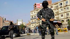Masked Egyptian security forces deploy in the Cairo