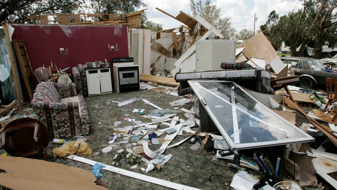 Some of the damage caused by Hurricane Charley in Zolfo Springs, Fla., on Aug. 18, 2004.