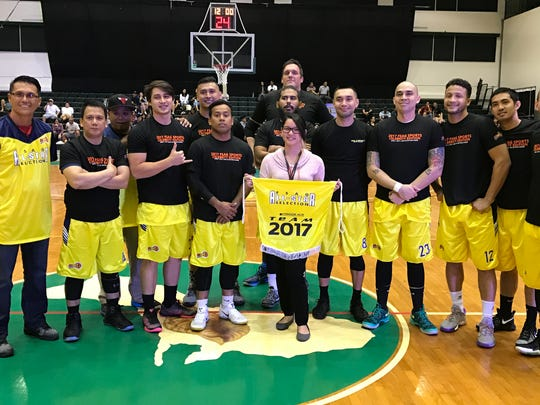 The Filipino Sports Association All-Start Select team poses before their match at the 2017 FSAG Celebrity Edition presented by Coldstone-Wendy's game on April 1 at the University of Guam Calvo Field House.