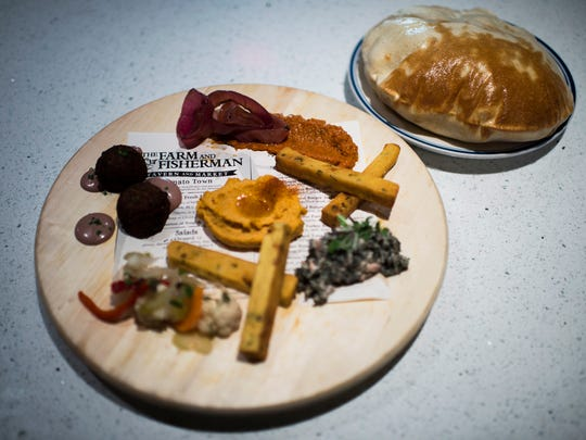 A Breads and Spreads dish on The Farm & Fisherman menu