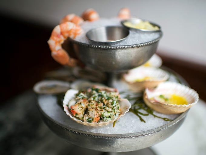 A king crab salad shown prominent with a seafood 'plateau'