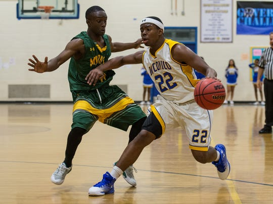 Wi-Hi's Dejour Foreman (22) carries the ball while Mardela's Makhai Bratten attempts to block.