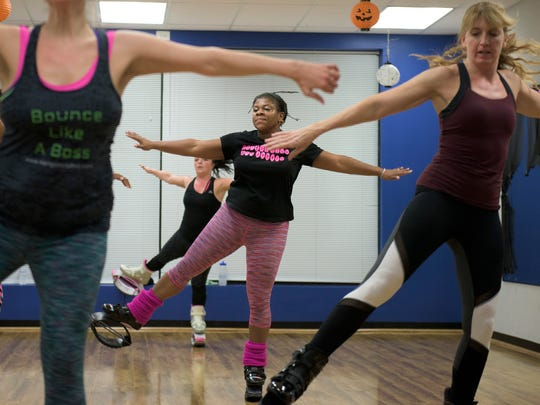Priscilla Tomkinson of Kangoo Club of South Jersey leads a workout Wednesday, Nov. 1, 2017 at Omega Sports in Sicklerville.
