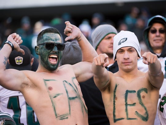 Eagles fans cheer their team on during a game against