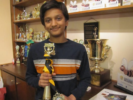 Jairam Hathwar, 12, of Painted Post, displays the trophy he won in March in the regional qualifier for the Scripps National Spelling Bee.
