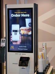 McDonald's has touchscreen ordering kiosks at its Green