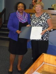 Mayor Eula Clarke presents a certificate of recognition to Sandy Deck, vice president of the Garden Club of Stuart in honor of the club's 80th anniversary.