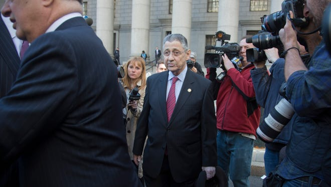 Former New York state Assembly Speaker Sheldon Silver, center, leaves court after a November trial date was set for a jury to hear the corruption case brought against him in New York.