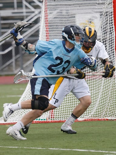 Suffern's CJ. Greco (23) runs past a Lakeland/Panas defender during the first half at Lakeland High School in Shrub Oak on May 8, 2014.
